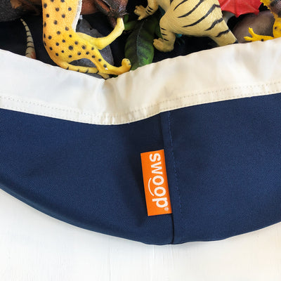 navy blue mini swoop bag for toy storage