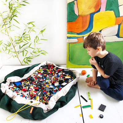 dark green lego storage bag and mat