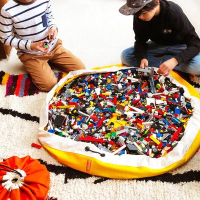 yellow swoop toy storage bag with lego bricks