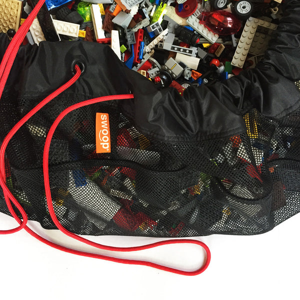 detail of black mesh toy bag with lego