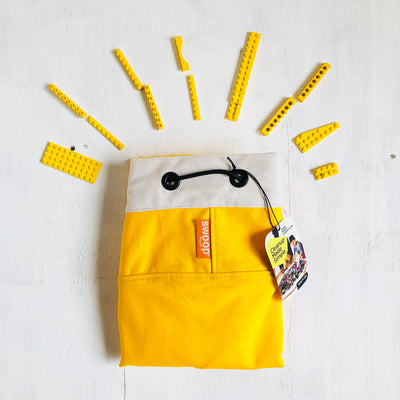 yellow canvas toy storage bag