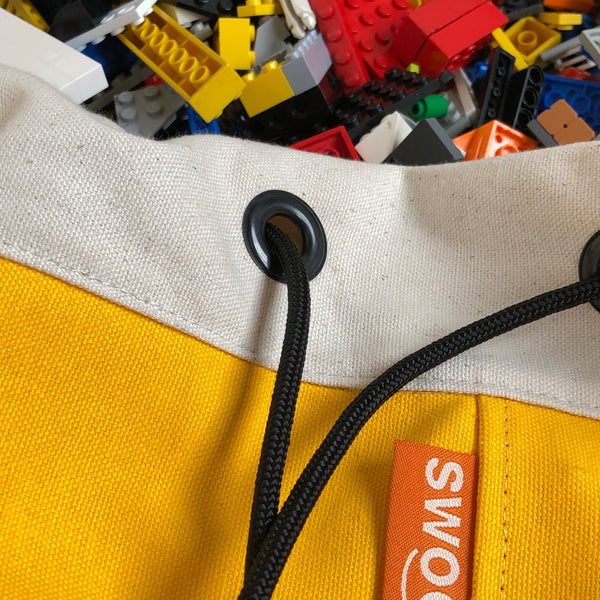 detail of yellow swoop bag
