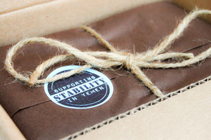 closeup of string and stability logo on gift-wrapped coffee bag