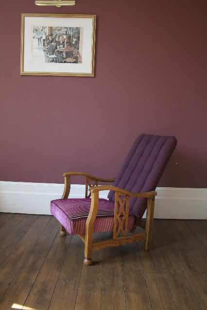 Edwardian Style Reciliner; oak frame and a upholstered fluted back. Covered in a smart Linwood plum velvet.