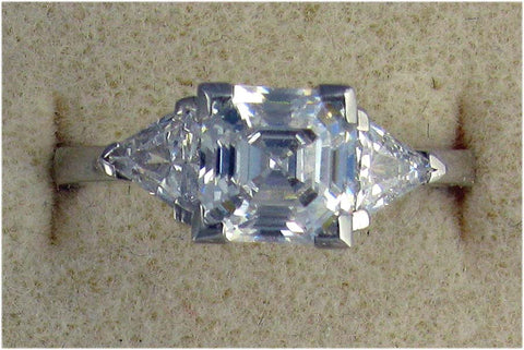 R0003 3CT TW CZ 2CT ASSCHER CENTER TRIANGLE SIDES RING