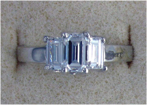 R0096 1.50 CT TW 1CT STEP CUT CZ CENTER .25 CT STEP CUT SIDES