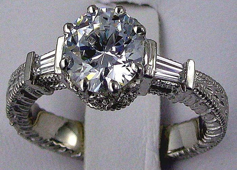 R0189 1.80CT TW 7MM RD CZ CENTER RD PAVE SIDES
