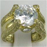 R0218 6.5CT TW  6CT RD CENTER PAVE SIDES RING