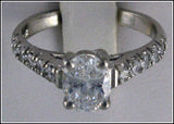 R0222 1.5 CT TW 1CT OVAL CZ CENTER ROUND SIDES