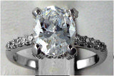 R0233 2.5 CT TW  OVAL CZ CENTER SIDE ROUND PAVE