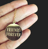 Friends Forever is written in all caps on the back of this BFF or sister's gift. Perfect for all your bridemaids.  Pendant is a round coin with 22 millimeters around.