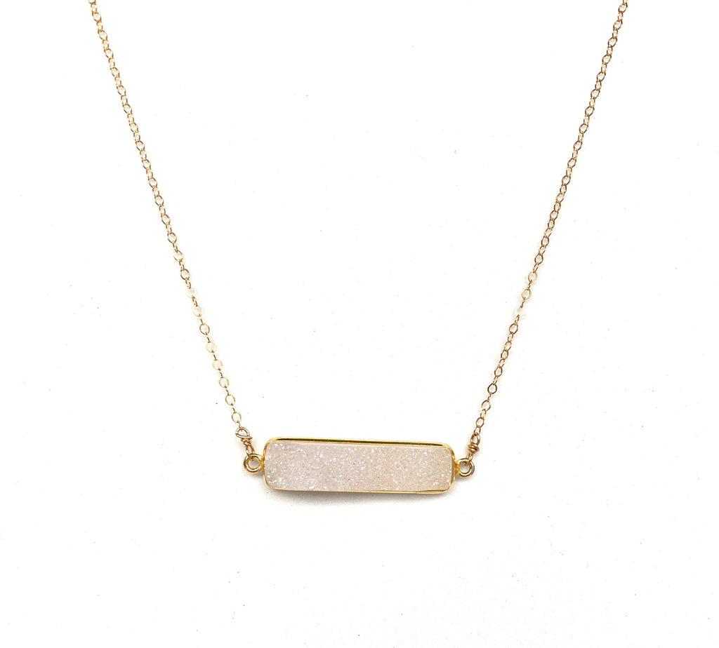 white druzy bar stone necklace connected on each end with chain.  Dainty and perfect for everyday wear.