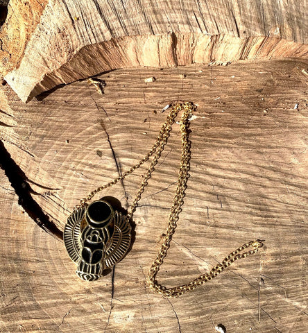 Black and gold scarab long necklace