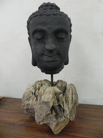 Buddha head with a teak wooden base