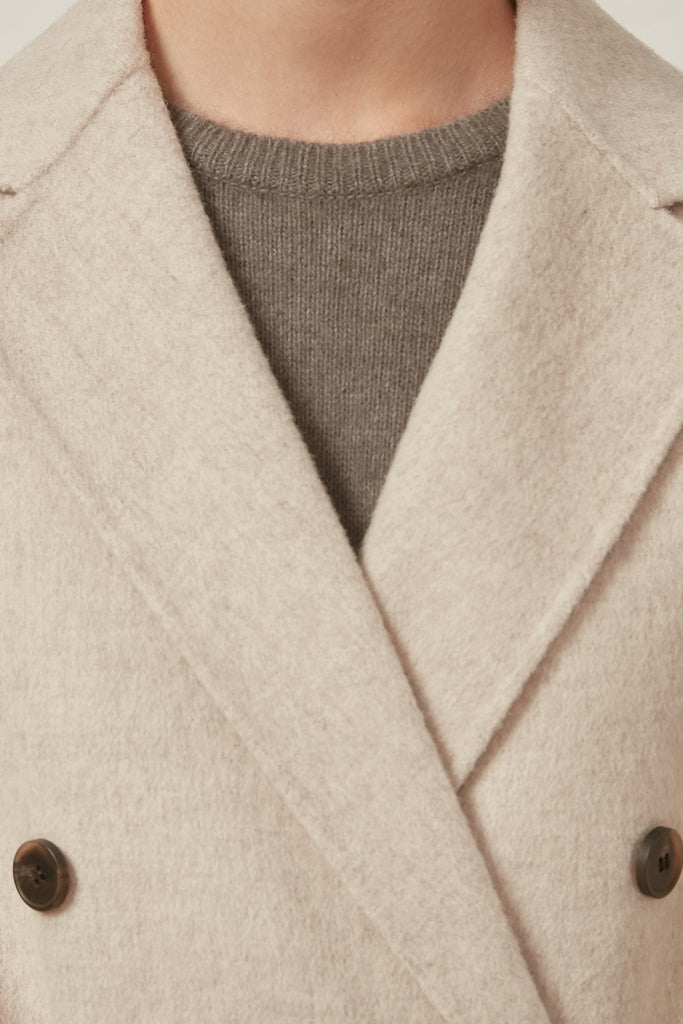 Belted double-breasted wool coat - Zelle Studio