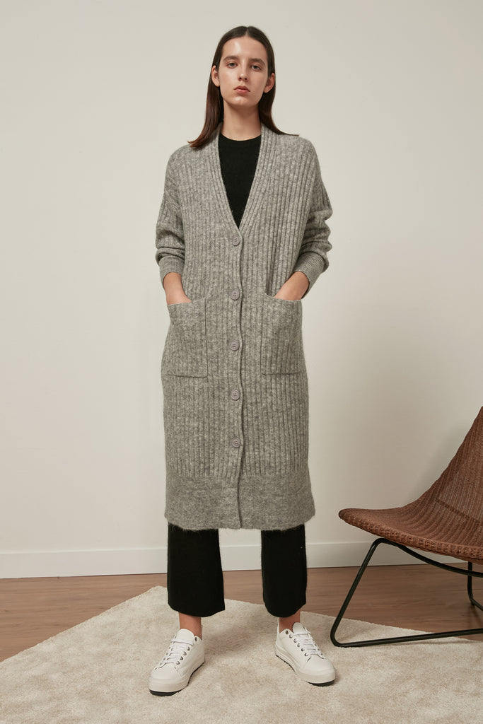 Raccoon fox and wool-blend trousers