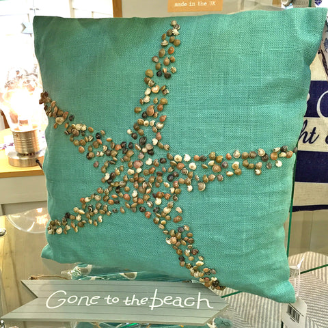 Dare to dream about sea-side holidays - shell cushion