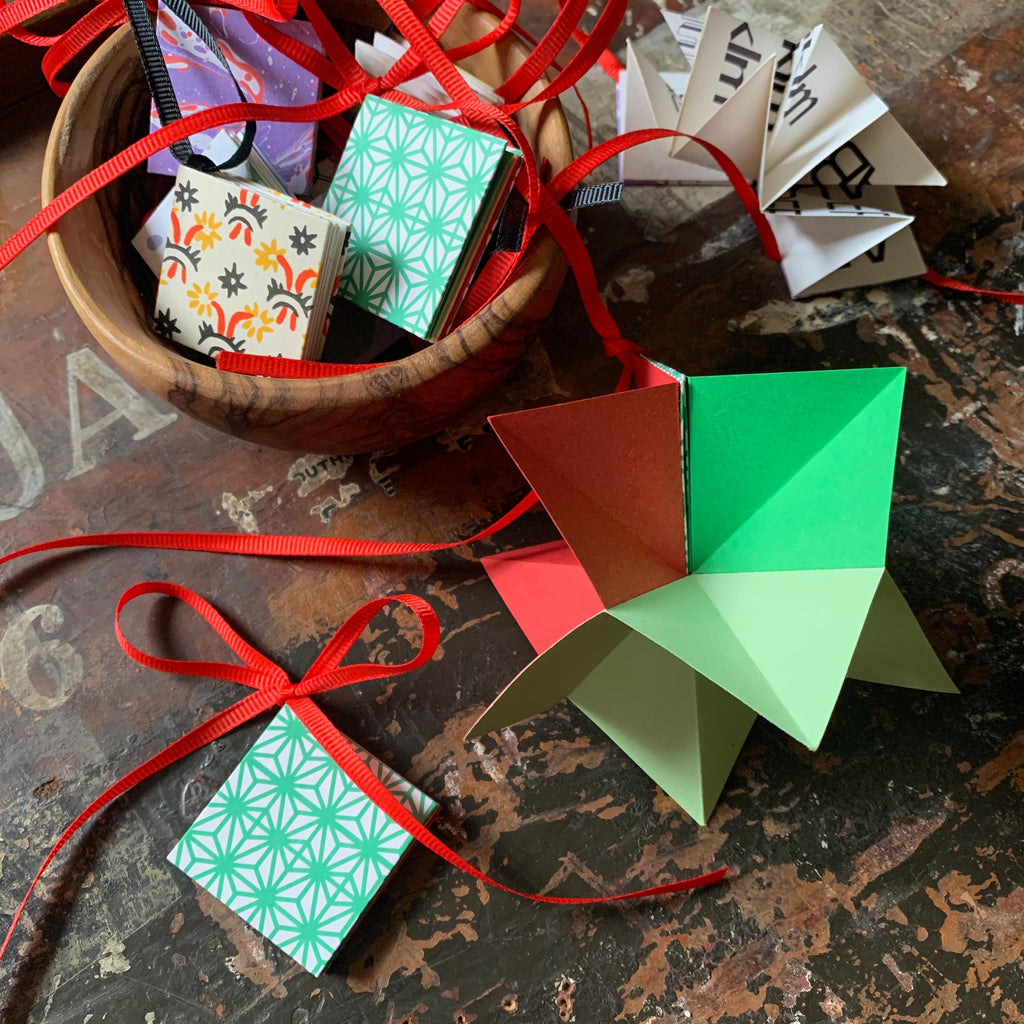 Learn how to make an origami star book decoration from coloured and patterned paper.