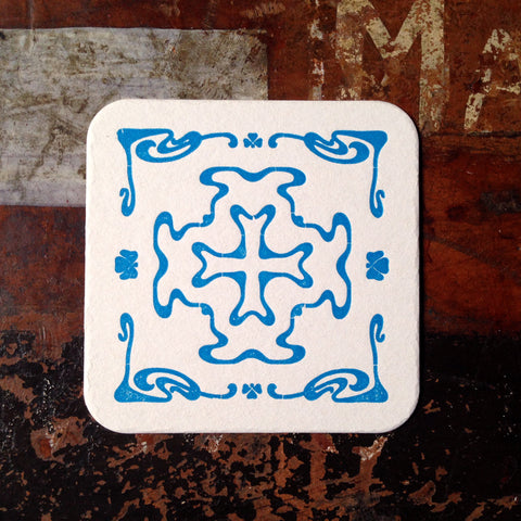 Art Nouveau cross pattern letterpress coaster, blue