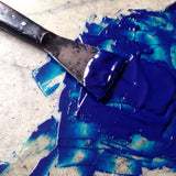 Mixing blue ink to print Art Nouveau letterpress coasters