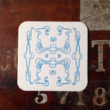 Art Nouveau panel pattern letterpress coaster, blue