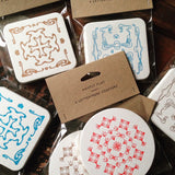 Packs of six Mostly Flat letterpress printed ornament coasters