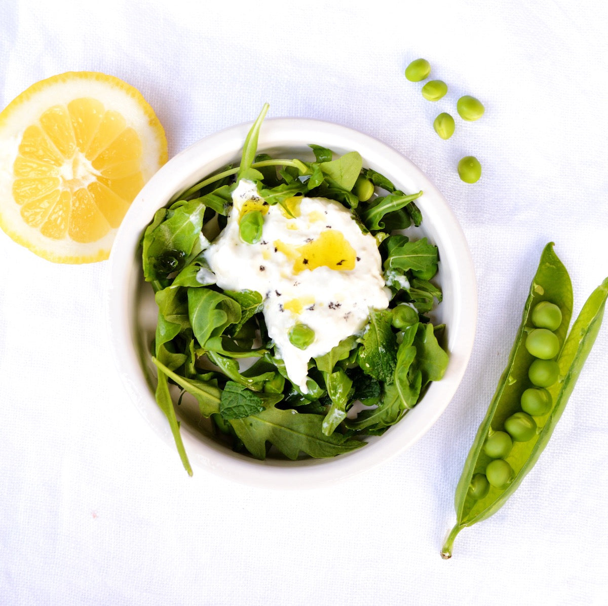 Burrata w/ Fresh Peas Rocket Mint & a drizzle of Lemon Olive Oil