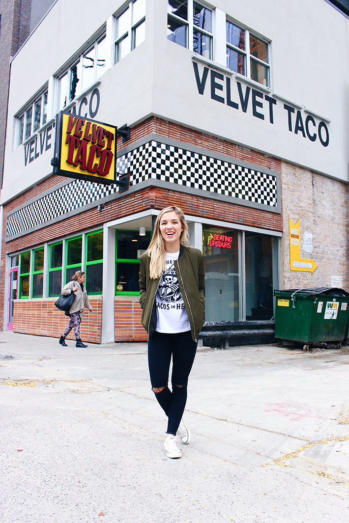 The Nom Stop outside her favorite taco joint, Velvet Taco, in Chicago, IL