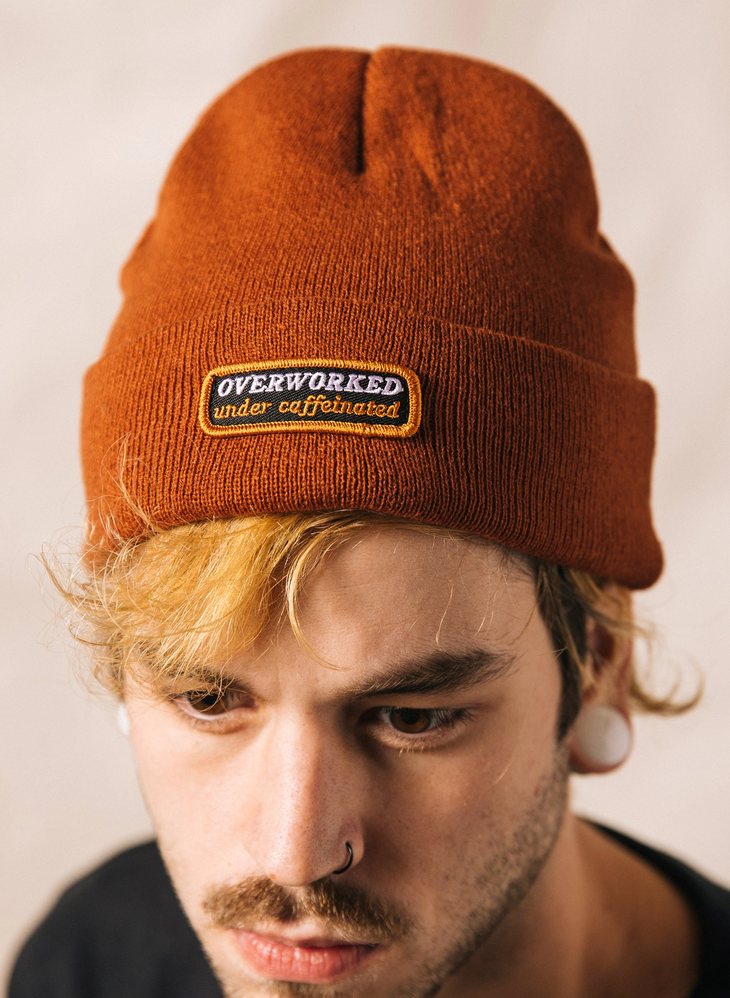 Overworked Under Caffeinated Coffee Barista Always Tired Snarky Knit Beanie Rust