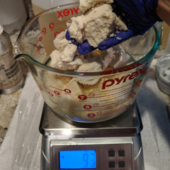 Measuring out shea butter for lip balm