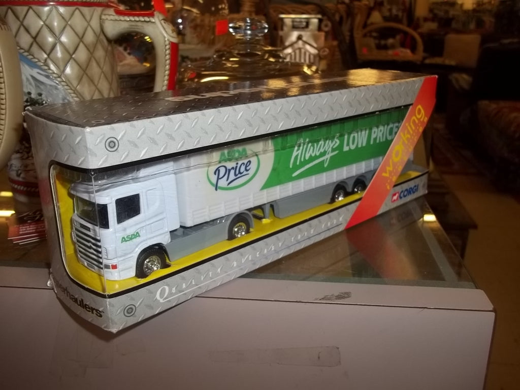 Wal-mart collectible toy semi truck in original box Corgi super hauler tractor cab with trailer in original box 9786