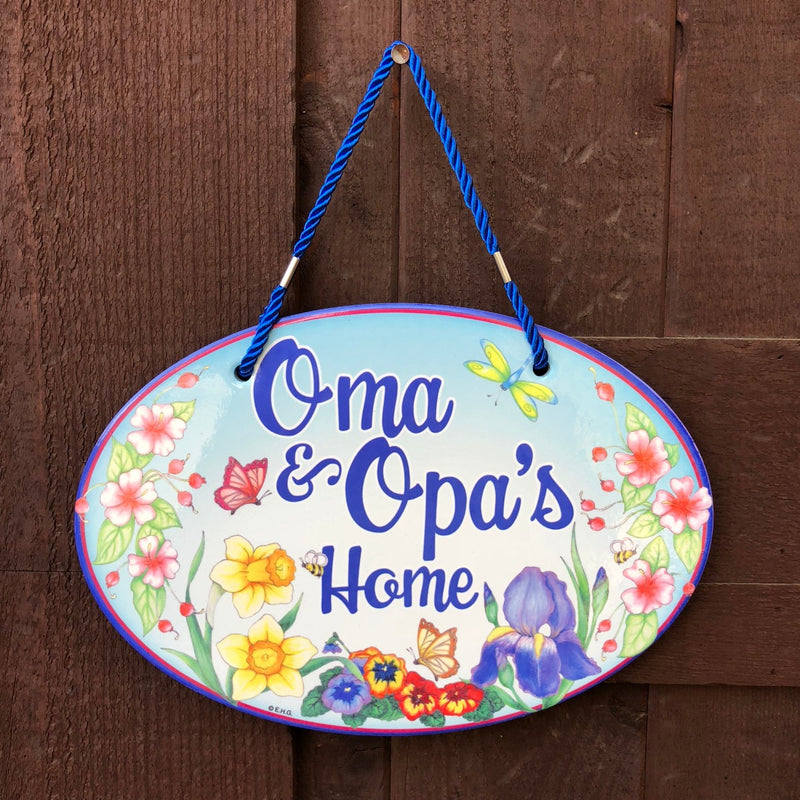 "Ceramic Door Sign with the words ""Oma & Opa's Home"" engraved"
