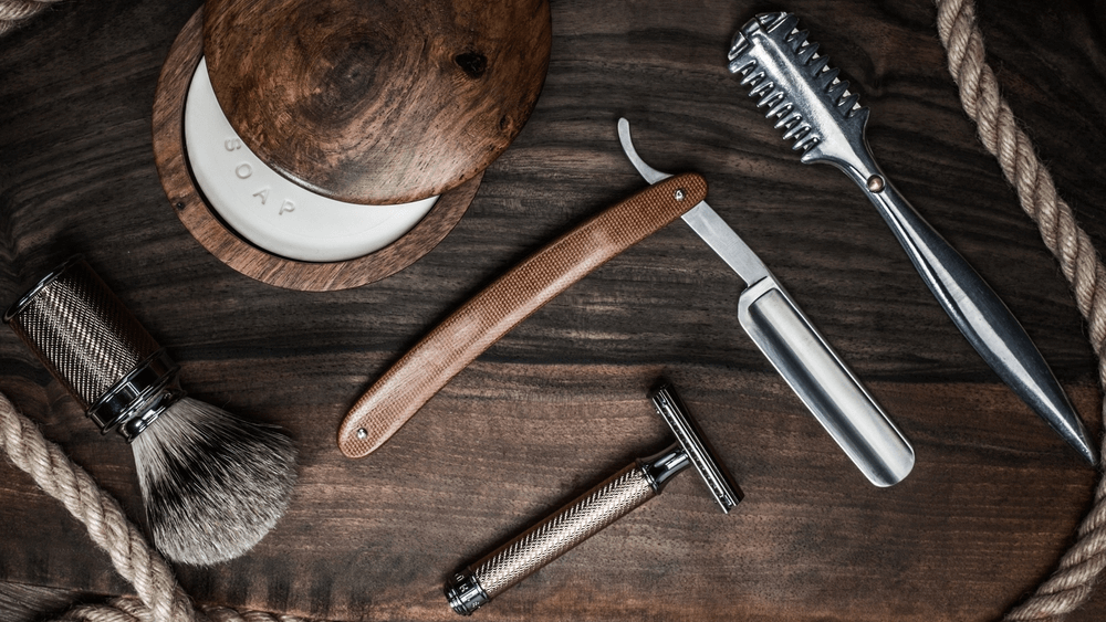 image of shaving products on a wooden surface