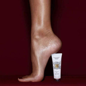 Tube of lord jones stiletto cream picture underneath model's heel as if it were a stiletto