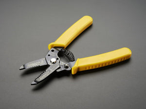 Multi-size wire stripper & cutter