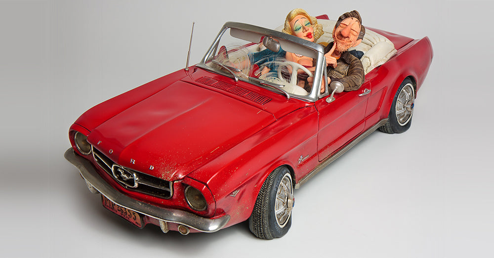 Guillermo Forchino sculpture of a red 65 Ford Mustang with flat tires