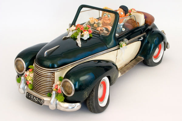 Guillermo Forchino sculpture of a car carrying a 'Just Married' couple