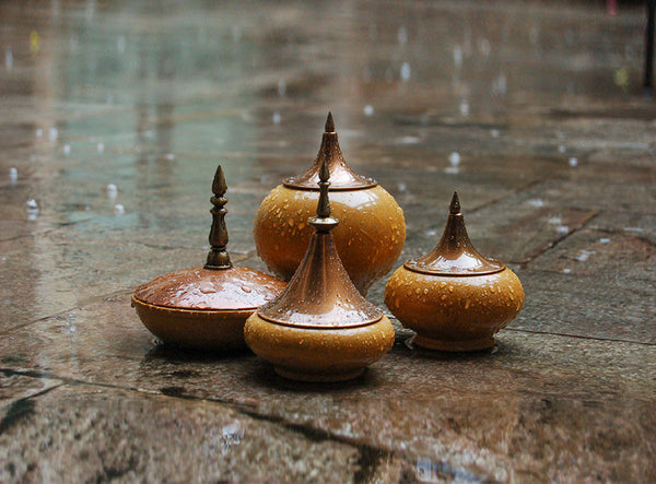 Marble Spire Jars by AnanTaya Decor, on stone floor in the rain