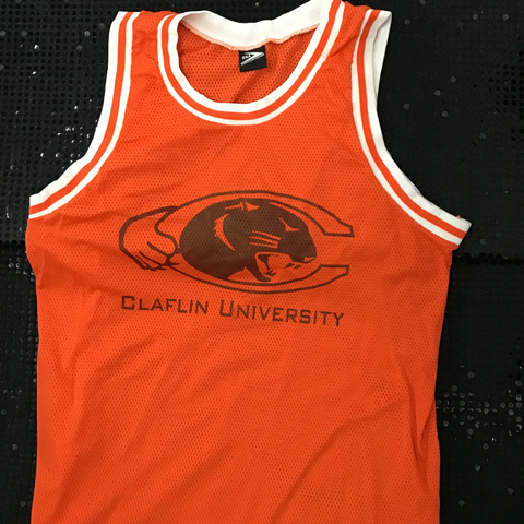 Orange sleeveless jersey shirt with black letters and logo.