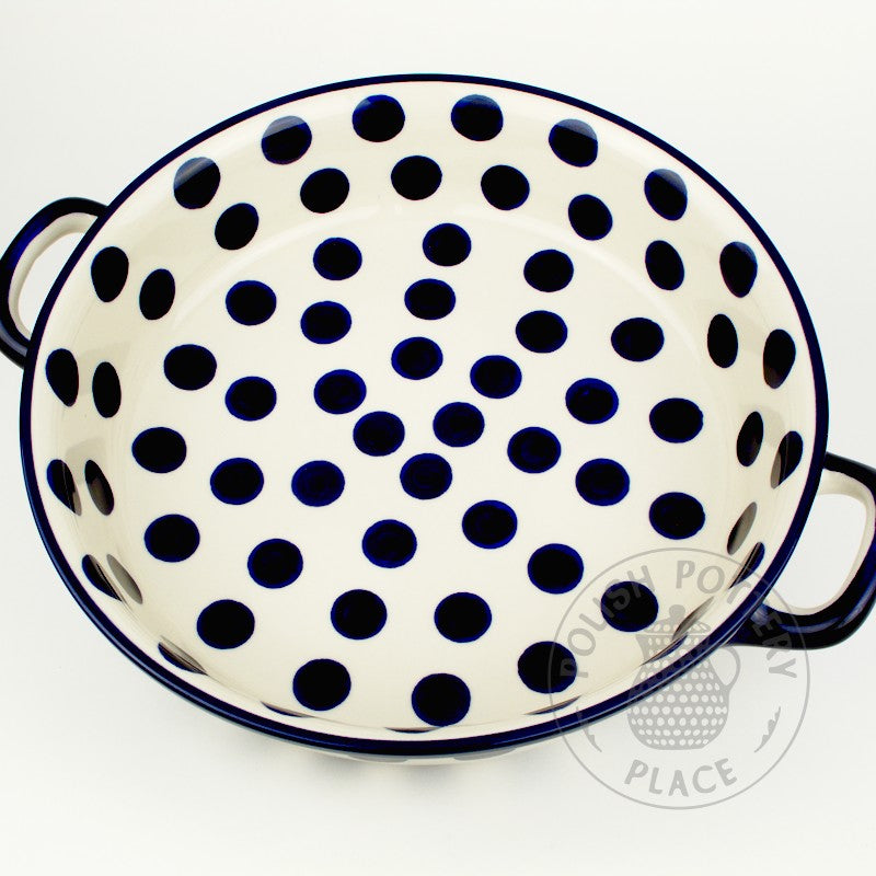 Large round polish pottery baker dish with handles and a blue on white big dots pattern