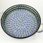 Large round polish pottery baker dish with handles and a green and blue poppy flower pattern