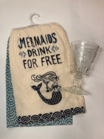 "Dishtowel reading ""Mermaids Drink for Free"" and a French Drinking Glass"