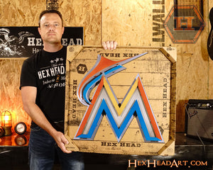 Miami Marlins M Logo 3D Metal Artwork in its shipping box