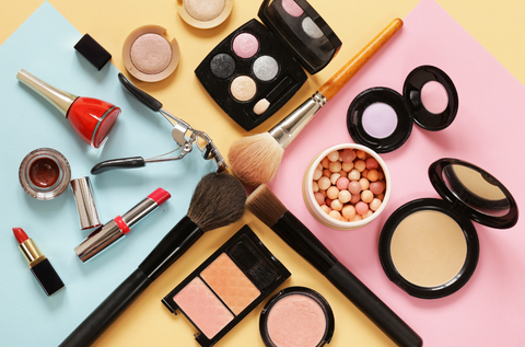 Makeup items on a multicolored surface