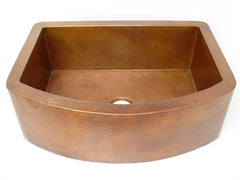 Farmhouse kitchen sink with round apron