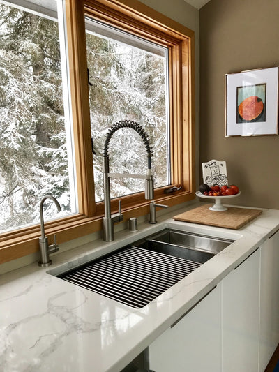 Stainless steel kitchen sink with offset drain