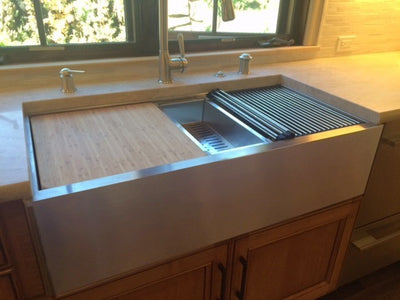 Large apron front farmhouse workstation sink with perfect seamless drain