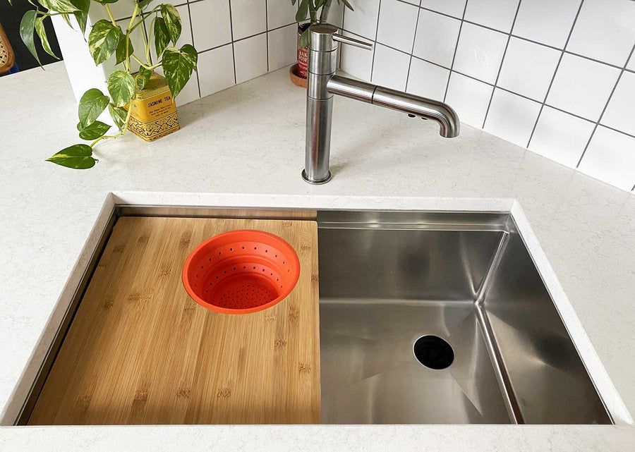 31 inch seamless drain workstation sink with cutting board accessory