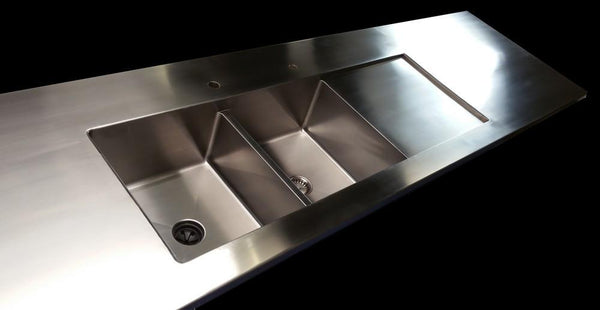 Walton - Any of our sinks beautifully welded into a custom stainless steel counter-top or island creates a perfectly seamless union..  pricing starts at $3375