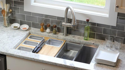 Stainless steel colander accessory that rests on a ledge kitchen sink